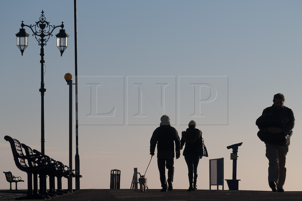 © Licensed to London News Pictures. 02/11/2016. Portsmouth, UK.  People enjoy a cool start in Southsea this morning, 2nd November 2016.  Today is set to be fine and dry across the South of the UK.  Photo credit: Rob Arnold/LNP