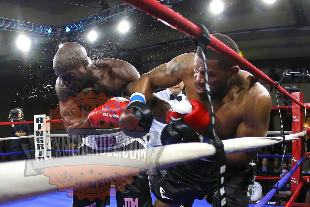 Mike Bolagun of Upper Marlboro, Maryland (R) and Terrance Marbar of St. Pete, Florida exchange blows in a heavyweight clash during a Nelsons Promotions boxing match at the Boca Raton Resort  and Club on Friday, May 26, 2017 in Boca Raton, Florida.  (Alex Menendez via AP)