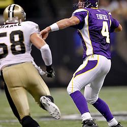 September 9, 2010; New Orleans, LA, USA; Minnesota Vikings quarterback Brett Favre (4) is pressured by New Orleans Saints linebacker Scott Shanle (58) during the NFL Kickoff season opener at the Louisiana Superdome. The New Orleans Saints defeated the Minnesota Vikings 14-9.  Mandatory Credit: Derick E. Hingle