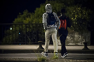 Some African migrants heading to France to cross the Spanish french border walking along Santiago bridge.  Irun (Basque Country). August 22, 2018. As the number of migrants arriving on the coasts of southern Spain incresead, more and more migrants are heading north to the border city of Irun. (Gari Garaialde / Bostok Photo)