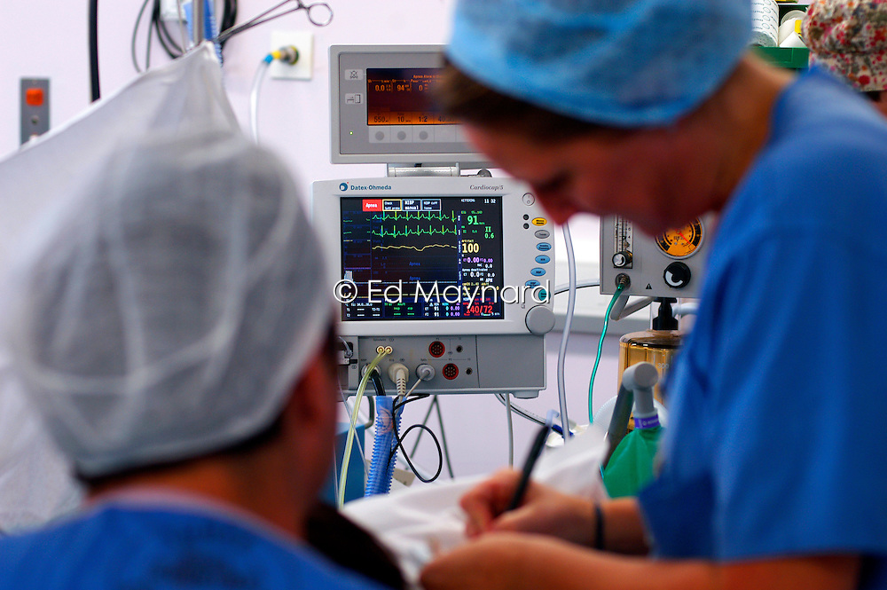Theatre staff in theatre as they prepare to deliver a baby by caesarean section, Kettering Hospital, Northamptonshire, UK.