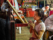 08 DECEMBER 2016 - BANGKOK, THAILAND:  A member of the cast prays backstage before a Chinese opera (also called ngiew in Thailand) performance at Pek Leng Keng Shrine in the Khlong Toei neighborhood of Bangkok. Public performances of music and celebration were banned during the first 30 days of the mourning period for Bhumibol Adulyadej, the Late King of Thailand. Now, nearly two months after the revered monarch's death, Bangkok street life is returning to normal and Chinese temples and shrines are once again scheduling operas.     PHOTO BY JACK KURTZ