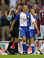Fotball<br /> England 2004/2005<br /> Foto: Colorsport/Digitalsport<br /> NORWAY ONLY<br /> <br /> Paul Dickov (Blackburn) is sent off by Referee Mr Alan Wiley after a late tackle on Konchesky -  West Ham United v Blackburn Rovers. 13/8/2005