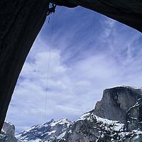 "ROCK CLIMBING. Willie Benegas on ""Electric Ladyland"",Washington Column, Yosemite NP. Half Dome bkg."