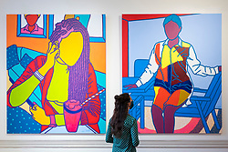 "© Licensed to London News Pictures. 08/10/2020. LONDON, UK. A staff member views ""Sweet Things"", 2020, and ""Mme. Limbong"", 2020, both by Ajarb Bernard Ategwa.  Preview of 1-54 Contemporary African Art Fair, the leading international art fair dedicated to contemporary art from Africa and its diaspora, taking place at Somerset House.  The fair showcases the work of more than 110 emerging and established artists from Africa and is the only physical art fair taking place during Frieze Week.  Photo credit: Stephen Chung/LNP"