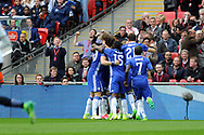 Chelsea players celebrate with  goalscorer Willian (in huddle) after he scores his teams 1st goal. The Emirates FA Cup semi-final match, Chelsea v Tottenham Hotspur at Wembley Stadium in London on Saturday 22nd April 2017.<br /> pic by Carl Robertson,  Andrew Orchard sports photography.