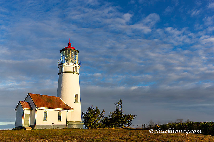 Oregon's oldest lighthouse at sunrise at Cape Blanco State Park, Oregon USA