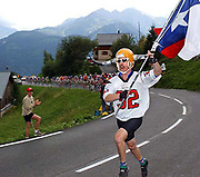 A fanatic runs ahead of the peloton on the Col de Saisies during stage seventeen - he had also been in action the day before on the Col de Galibier...but this man is not a Texan!