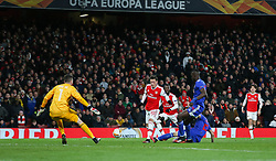 Konstantinos Tsimikas of Olympiacos puts in a last ditch tackle on Mesut Ozil of Arsenal - Mandatory by-line: Arron Gent/JMP - 27/02/2020 - FOOTBALL - Emirates Stadium - London, England - Arsenal v Olympiacos - UEFA Europa League Round of 32 second leg