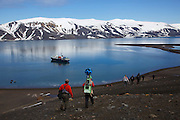 Visitors on the hike from Baily Head to Whaler's Bay, Deception Island, Antarctica.