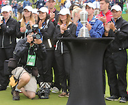 28 JUN 15  Ace golf shooter Mike Sparky Cohen crawling the 18th green with the Claret Jug after Sunday's Final Round at The Travelers Championship at TPC River Highlands in Cromwell,Conn. (photo credit : kenneth e. dennis/kendennisphoto.com)