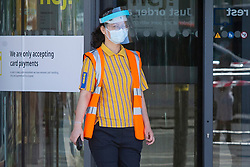 © Licensed to London News Pictures. 01/06/2020. London, UK. An employee wears a medical mask and face shield as they supervise customers outside the Greenwich branch of Ikea which reopened today. The store has been closed since lockdown began in March. Photo credit: George Cracknell Wright/LNP