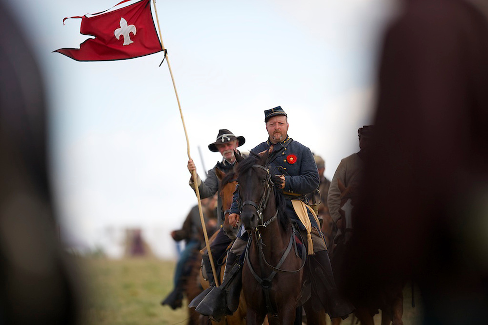 Confederate cavalry ride towards the starting position of Pickett's Charge the finale of a four day Gettysburg Anniversary Committee 150th Gettysburg reenactment in Gettysburg, PA on July 7, 2013.