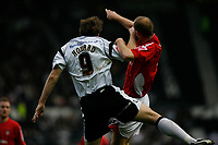 Derby Co No 9, Steve Howard challanges for the ball with a Wrexham defender