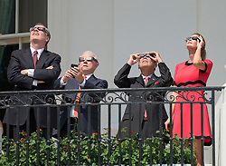 From left to right: United States Trade Representative Robert E. Lighthizer, US Attorney General Jeff Sessions, US Secretary of Commerce Wilbur Ross, and Ivanka Trump look at the partial eclipse of the sun from the Blue Room Balcony of the White House in Washington, DC, USA, on Monday, August 21, 2017. Photo by Ron Sachs/CNP/ABACAPRESS.COM