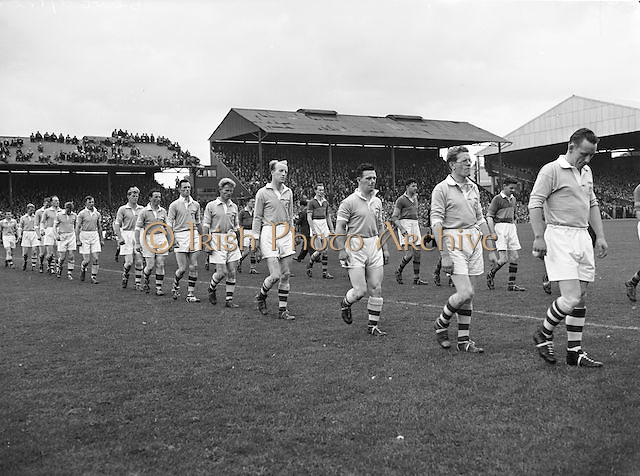 The Dublin team line out onto the pitch before the All Ireland Senior Gaelic Football Final Kerry v Dublin in Croke Park on the 25th September 1955. Kerry 00-12 Dublin 01-06.