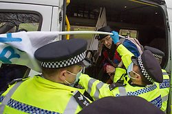 © Licensed to London News Pictures.21/11/2020. London, UK. An anti-mask and lockdown protestor is being arrested after small group gather in Hyde Park during a March for our Freedom demonstration in central London. Photo credit: Marcin Nowak/LNP