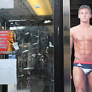 Great British diver Tom Daley on shop window advertising Street in London City centre as London prepares for the  London 2012 Olympic games, UK. 14th July 2012. Photo Tim Clayton