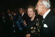 Prime Minister Margaret Thatcher arrives with her late-husband Dennis at the formal 1990 Tory Party conference ball. Thatcher died on April 8th 2013 after suffering a stroke while staying in the Ritz Hotel, London.