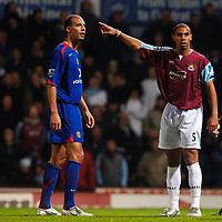 Photo: Daniel Hambury.<br />West Ham United v Manchester United. The Barclays Premiership. 27/11/2005.<br />West Ham's Anton Ferdinand and Manchester's Rio Ferdinand.
