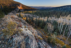"""Sunrise on """"The Wall"""" with aspens in fall color along Elk Creek , Vermejo Park Ranch, New Mexico, USA."""