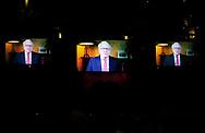 Berkshire Hathaway CEO Warren Buffett is seen speaking on giant TV screens at the start of the Berkshire Hathaway annual meeting in Omaha, Nebraska, U.S. May 6, 2017. REUTERS/Rick Wilking