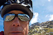 Portrait of an touring cyclist - Swiss Alps