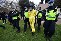 © Licensed to London News Pictures. 20/03/2021. London, UK. Police detain a person gathering in Hyde Park to take part in a Rally for Freedom in central London, to protest against the continued lockdown restrictions imposed to fight the spread of coronavirus. Similar events are taking place at cities around the world. Photo credit: Ben Cawthra/LNP
