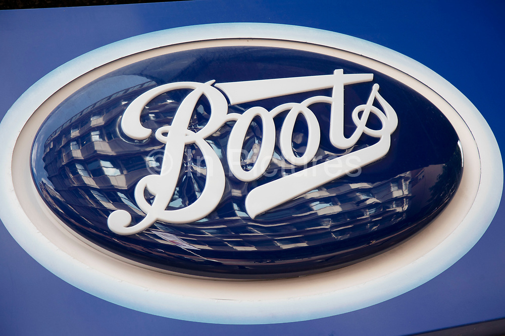 Sign for the health, beauty and chemist brand Boots in Birmingham, United Kingdom.