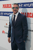 Atletico de Madrid´s coach Diego Pablo Simeone receive the Best Coach Award during MARCA Football Awards ceremony in Madrid, Spain. November 10, 2014. (ALTERPHOTOS/Victor Blanco)