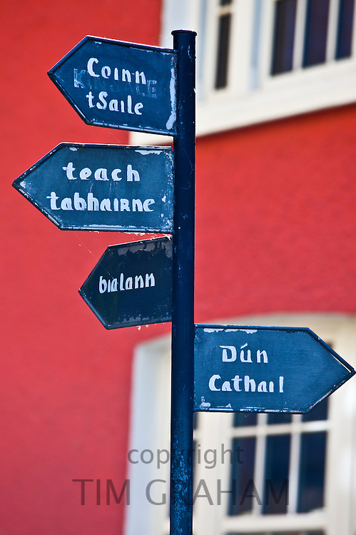 Gaelic signpost to Kinsale and other destinations in Timoleague, County Cork, Ireland