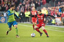 December 9, 2017 - Toronto, Ontario, Canada - Toronto FC forward SEBASTIAN GIOVINCO (10) dribbles the ball against Seattle Sounders midfielder CRISTIAN ROLDAN (7) during the MLS Cup championship match at BMO Field in Toronto, Canada.  Toronto FC defeats Seattle Sounders 2 to 0. (Credit Image: © Mark Smith via ZUMA Wire)