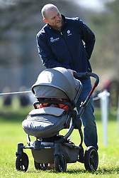 Mia Tindall hitches a ride as Mike Tindall pushes her and daughter Lena in her pram on day two of the Gatcombe Horse Trials at Gatcombe Park, Minchinhampton, Gloucestershire, UK, on the 24th March 2019. 24 Mar 2019 Pictured: Mike Tindall pushes daughter Lena in a pram on day two of the Gatcombe Horse Trials at Gatcombe Park, Minchinhampton, Gloucestershire, UK, on the 24th March 2019. Photo credit: James Whatling / MEGA TheMegaAgency.com +1 888 505 6342