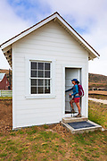 Hiker at the visitor center at Bechers Bay, Santa Rosa Island, Channel Islands National Park, California USA