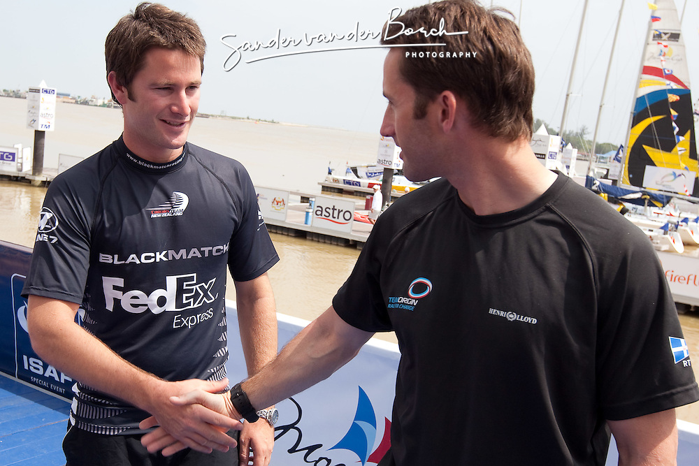 Ben Ainslie (GBR) and Adam Minoprio (NZL) shake hands after the Boat draw for the final. Monsoon Cup 2009. Kuala Terengganu, Malaysia. 6 December 2009. Photo: Sander van der Borch / Subzero Images