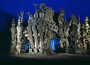 French postman, Ferdinand Cheval, born in 1836 was buried with his tools inside the Ideal Palace, Hauterives, France which took him 33 years to build. It came to him in a dream. It has been a monument since 1969.
