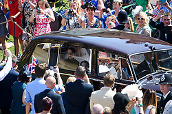 © Licensed to London News Pictures. 19/05/2018. London, UK. A car carrying the bride, MEGHAN MARKLE< arrives at the church.  The wedding of Prince Harry, The Duke of Sussex to Meghan Markle, The Duchess of Sussex, at St George's Chapel in Windsor. Photo credit: Ben Cawthra/LNP