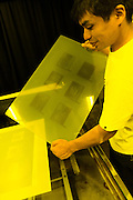 Removing the exposed gelatine-coated glass plate from on top off the negative. Benrido collotype atelier, Kyoto, Japan, October 9, 2015. The Benrido collotype atelier in Kyoto was founded in 1887 and is the only full-scale commercial collotype atelier in the world. Collotype is a historic photographic printing process that makes use of plates coated in gelatine. It produces prints of unrivalled quality.