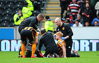 Hull City's Stephen Quinn receives treatment for an injury caused by Manchester United's Marouane Fellaini who was shown a red card for the challenge<br /> <br /> Photographer Chris Vaughan/CameraSport<br /> <br /> Football - Barclays Premiership - Hull City v Manchester United - Sunday 24th May 2015 - Kingston Communications Stadium - Hull<br /> <br /> © CameraSport - 43 Linden Ave. Countesthorpe. Leicester. England. LE8 5PG - Tel: +44 (0) 116 277 4147 - admin@camerasport.com - www.camerasport.com