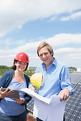 Female architect planning client solar energy meeting