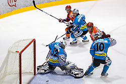 Robert Sabolic of Jesenice (R) scores vs Alex Westlund and Reid Cashman of Linz during ice-hockey match between HK Acroni Jesenice and EHC Liwest Linz in 3rd Round of EBEL league, on September 17, 2010 at Arena Podmezakla in Jesenice, Slovenia. (Photo By Vid Ponikvar / Sportida.com)