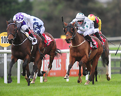 Canary Row and Ross Coakley (right) win the Kone Handicap from Vocal Music ridden by Kevin Manning (left). during day three of the October Festival at Galway Racecourse.