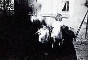 toddler and little girl playing in the garden France vintage