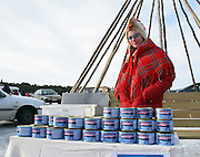 Sami girl selling reindeer meat, Inari, Finland. Reindeer racing was taking place on lake Inari. 3 April 2005
