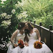 Bride and Bride kiss