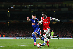 Bukayo Saka of Arsenal attempts to take on Lazar Randjelovic of Olympiacos - Mandatory by-line: Arron Gent/JMP - 27/02/2020 - FOOTBALL - Emirates Stadium - London, England - Arsenal v Olympiacos - UEFA Europa League Round of 32 second leg
