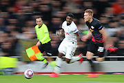 A slow shutter shot as Defender Serge Aurier of Tottenham and Defender Marcel Halstenberg Of Leipzig chase the ball during the UEFA Champions League match between Tottenham Hotspur and RB Leipzig, at The Tottenham Hotspur Stadium, Thursday, Feb. 20 2020,  in  London, United Kingdom. (Mitchell Gunn/Image of Sport)