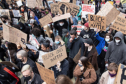 © Licensed to London News Pictures. 07/06/2020. Manchester, UK. A Black Lives Matter demonstration against police violence is held in Manchester City Centre . Ongoing protests have and are being held in Manchester and around the world , after George Floyd was killed whilst being restrained by police in Minneapolis on 25th May 2020 . Photo credit: Joel Goodman/LNP