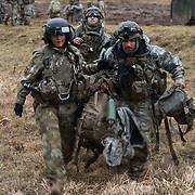 U.S. Army Sgt. 1st Class Marcia McNeill, Charlie Company, 2nd Battalion, 3rd Combat Aviation Brigade, 3rd Infantry Division, and a litter team from 1st Battalion, 8th Cavalry, 1st Cavalry Division carry a patient to the waiting HH-60M MEDEVAC Blackhawk during Combined Resolve XIII, Feb. 1, 2020,  at Hohenfels Training Area.  (U.S. Army photo by Sgt. 1st Class Garrick W. Morgenweck)