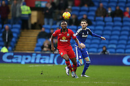 Fode Koita of Blackburn Rovers looks to get to the ball ahead of Scott Malone of Cardiff city. Skybet football league championship match, Cardiff city v Blackburn Rovers at the Cardiff city stadium in Cardiff, South Wales on Saturday 2nd Jan 2016.<br /> pic by Andrew Orchard, Andrew Orchard sports photography.